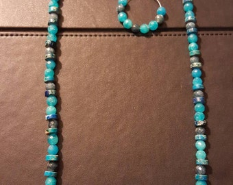 Blue stone beaded necklace and earrings.
