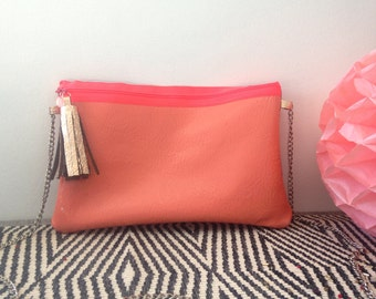 In fuchsia & coral leather shoulder bag.