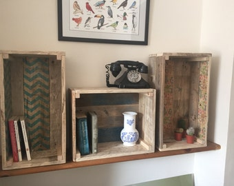 Various handmade wooden storage/shelving crate with different designs.