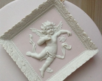 Angelic cupid pink and white porcelain wall plaque