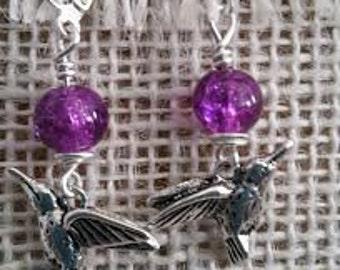 Detailed silver humming birds with fuscia glass bead on lever-back ear wires