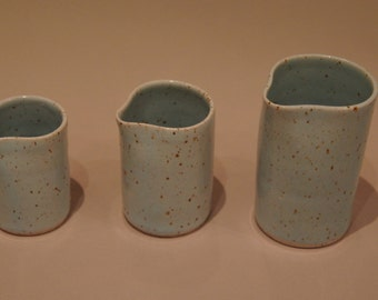 Three different sized pourers in spotty blue stoneware