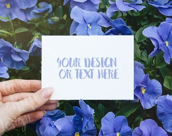 White card in Women Hand on the Background of Flowers / Blue Flowers / Card Mockup / Stock Photography / Product Mockup / High Res File