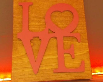 Wooden pink love sign