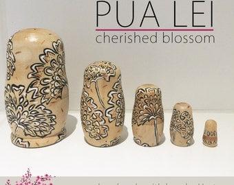 PUA Lei-blossom nesting dolls