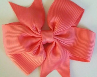 Coral bow by RoselliesClosetshop