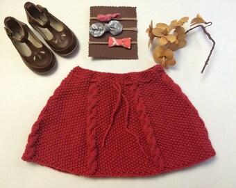 12-20 months . Reddish , raspberry color skirt . Handmade knitted
