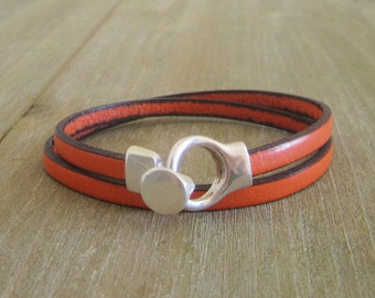Leather Orange, 2 wrist turns, silver clasp strap.