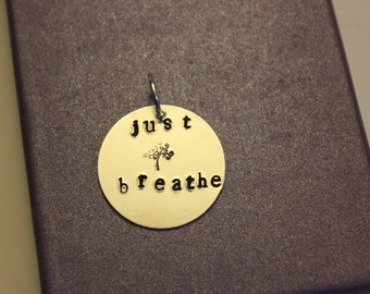 "Stamped pendant, ""just breathe"""