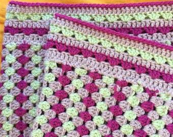 crochet blanket, pink, green & oatmeal.