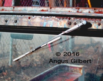 Rusting jeep windshield and wiper