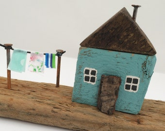 Small turquoise driftwood seaside cottage