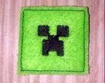 Green Block Head Feltie Embroidery Design