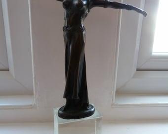bronze lady on glass plinth