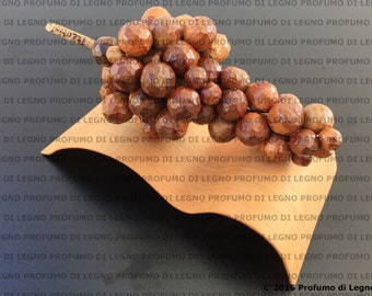 Bunch of grapes in natural wood-design object and furnishing
