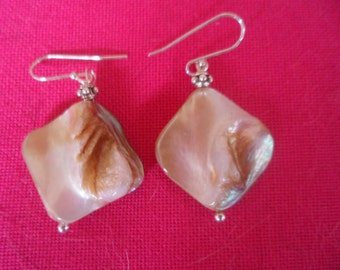 Earrings in silver and Baroque pearls