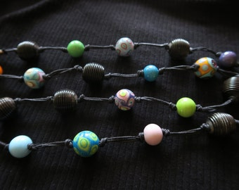 A long chain of handmade glass beads by approximately 96 cm.