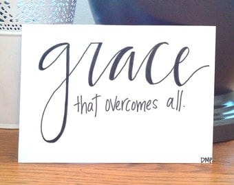 Grace that overcomes all, Handmade Calligraphy 5x7 White Print