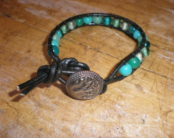 Beaded leather bohemian handmade single wrap bracelet with turquoise, aqua, blue beads, black leather, and metal button