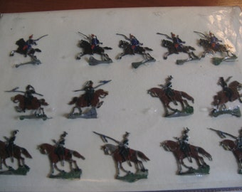 Fourteen old tin soldiers on horseback around 1920 ... from France!