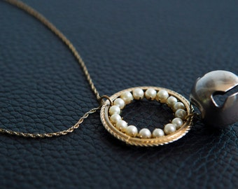 Long necklace, Assembly vintage of a chain twisted with a Crown of pearls and a cute Jingle Bell