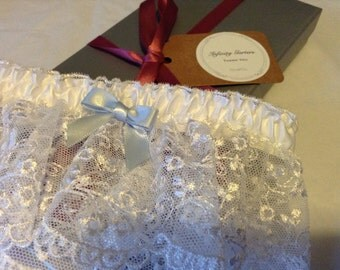 White wide lace garter with satin ribbon and baby blue bow