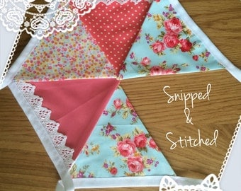 Vintage style bunting, with a cute cotton lace accent.