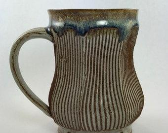 mug with floating blue to tan glaze