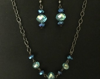 Blue glass gunmetal necklace and earrings