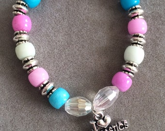 Gymnast stretch bracelet with charm in pink and blue
