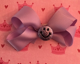Glitter smiley faces on bows