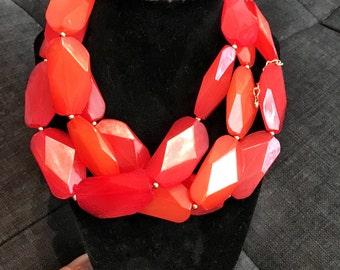 Bright orange plastic necklace