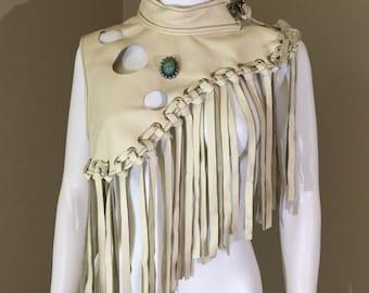 Fringed leather cape
