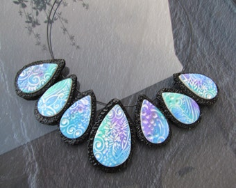 Necklace in light blue green purple