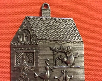 """Grunewald Folk Art """"Home for the Holidays"""" third in the series pewter Christmas ornament"""
