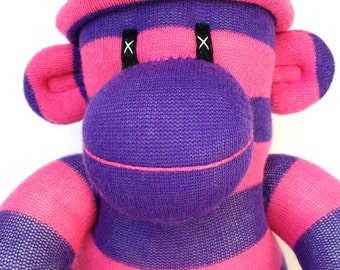 Cuddly sock monkey toy -purple and pink striped with removable pom pom hat ce certified