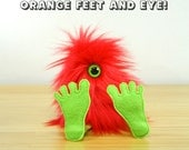 A custom Nervous Nelly with red fur and orange feet and eye