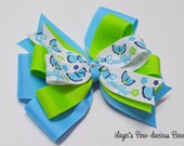 Large Layered Butterfly Hair Bow or Headband, blue and green pinwheel bow