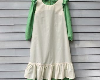 Girl, size 8/10, pioneer costume, green and cream.