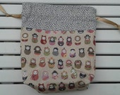 Of Many Disguises - drawstring bag, knitting bag, crochet bag, craft bag