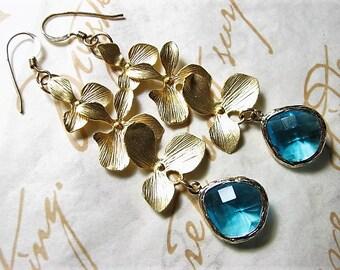 Atlantis, Cascading Gold Orchid & Capri Blue Framed Glass Teardrop Earrings