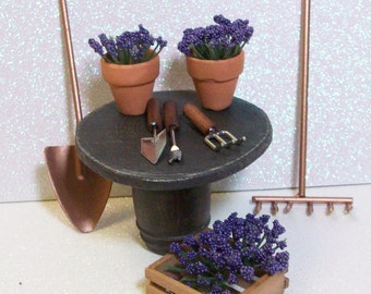 Fairy or gnome Garden miniature wood table with flower pots and gardening tools