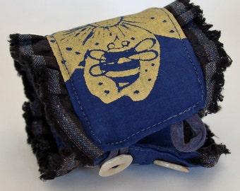 Bee in flower textile art wrist cuff, fabric bracelet, blue and gold, honey bee screenprint, hand dyed, wearable art accessory, fiber artist