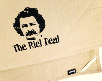 The Riel Deal kitchen dish towel. Manitoba Louis Riel silk screened cotton tea towel.
