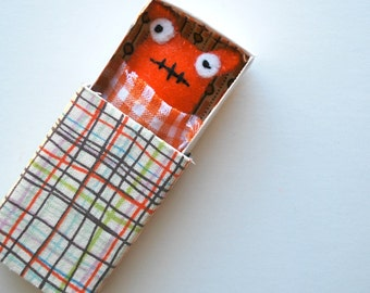 Orange Matchbox Monster with play accessories