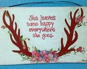 Handpainted She Leaves a Little Happy Antlers and Rosettes Sign in light aqua and pastels