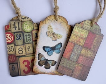 Original mixed media collage wooden tags. Map, butterflies, numbers. Altered art in red/browns. Set of 3