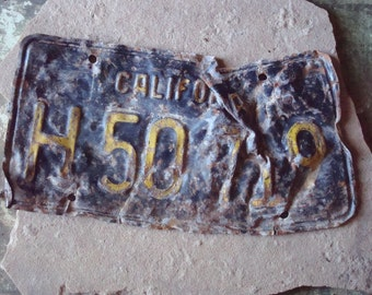 Rusted Metal California Automobile Black and Yellow License Embossed Numbers -