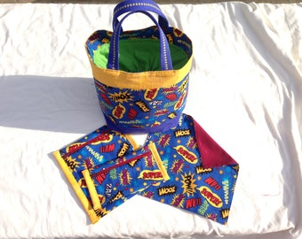 Superhero fabric lunch bag set. Includes waterproof, reusable zippered sandwich & snack bags, and cloth napkin