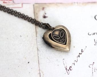 alien. heart locket necklace. in brass ox jewelry
